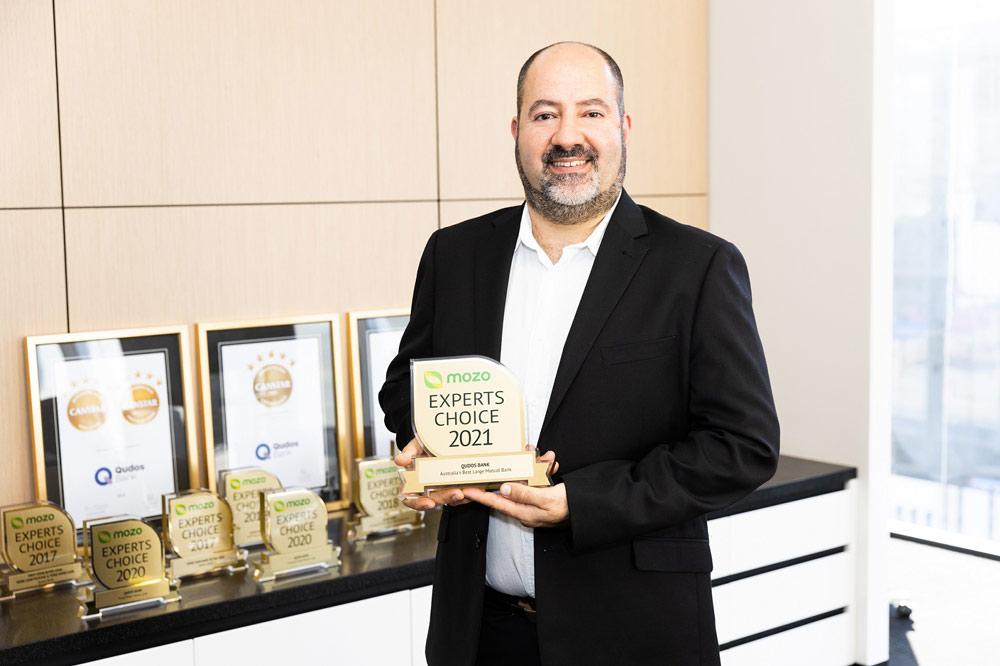 Qudos Bank CEO Michael holding Mozo Experts Choice Australia's Best Large Mutual Bank 2021 award